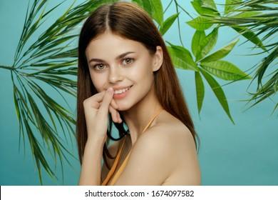 Beautiful woman palm leaves charm swimsuit