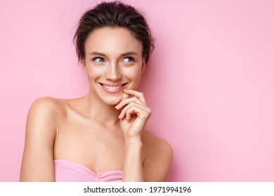 Beautiful woman with perfect skin on pink background. Beauty and skin care concept