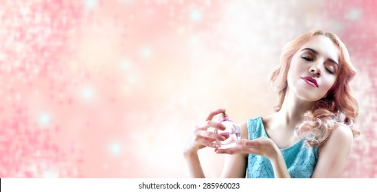 Beautiful woman with perfume bottle in flowers on pink background