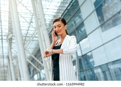 Beautiful Woman With Phone Work Near Business Office
