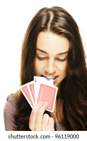 beautiful woman picks a poker card with her teeth on white background