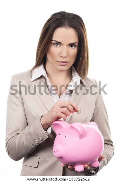 beautiful woman with piggy bank and coin