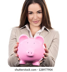 beautiful woman with piggy bank on white background