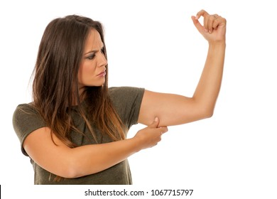 beautiful woman pinching fat on her hand on white background