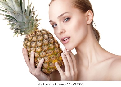 Beautiful woman with pineapple isolated on white background