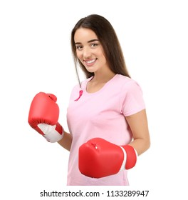 Beautiful woman with pink ribbon and boxing gloves on white background. Breast cancer concept