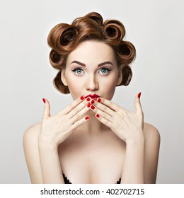 Beautiful woman pinup style portrait. Perfect manicure, makeup and hair.