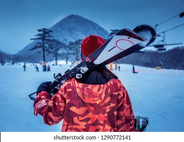 Beautiful woman play ski in white snow