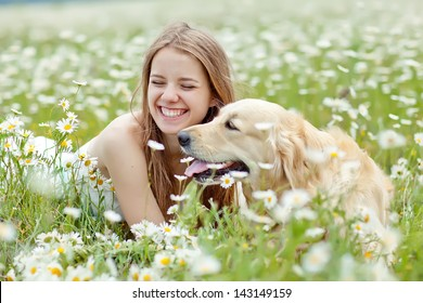 Beautiful woman playing with her ??dog. Outdoor portrait. series