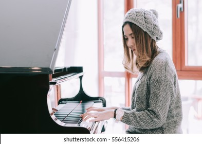 Beautiful woman playing piano and tone color.
