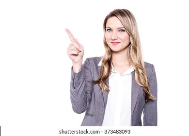 Beautiful woman pointing away, copy space concept