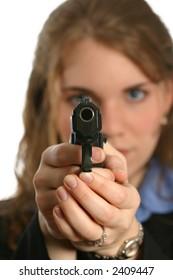 beautiful woman pointing handgun with gun in focus