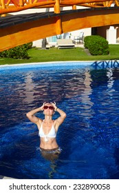 Beautiful woman in the pool. Relaxation at tropical resort