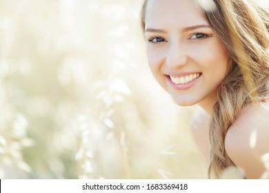 Beautiful woman. Portet of a beautiful smiling woman on nature.