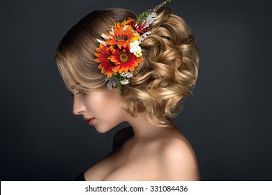 Beautiful woman portrait with autumn flowers in hair