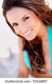 Beautiful woman portrait at the beach smiling
