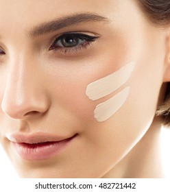 Beautiful woman portrait beauty skin healthy and perfect makeup Skin tone cream lines on woman face.