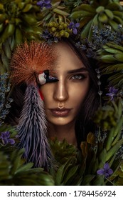 Beautiful woman portrait with bird and flowers