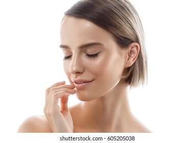 Beautiful woman portrait face with hand studio isolated white background