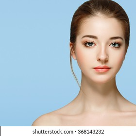 Beautiful woman portrait face studio isolated on blue