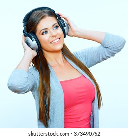 Beautiful woman portrait with headphones. Studio isolated. Music casual style.