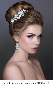 Beautiful woman portrait with jewelry in hair and tender make up. Luxury bride.
