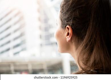 Beautiful woman portrait looking building on walkin street.