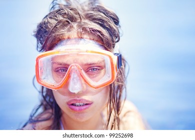 Beautiful woman portrait on the beach wearing snorkeling equipment, water sport, healthy lifestyle concept