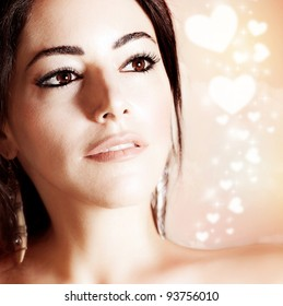 Beautiful woman portrait over romantic hearts background, female on Valentine's day, elegant girl face with abstract romantic backdrop, love concept