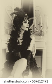 Beautiful  woman, portrait in retro  style .  Old photo. Vintage toning.