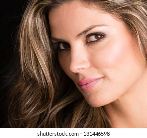 Beautiful woman portrait smiling - isolated over black background