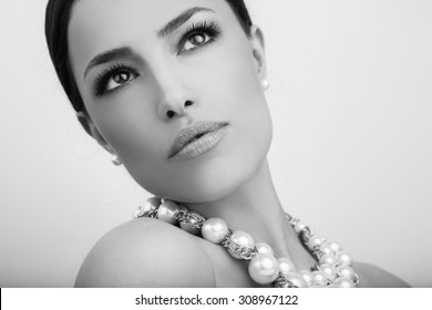 beautiful woman portrait with stylish pearl necklace, black and white
