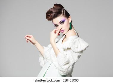 beautiful woman portrait wearing white dress and fur