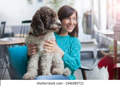 beautiful woman posing with her dog