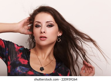 Beautiful woman posing in necklace and earrings. Closeup