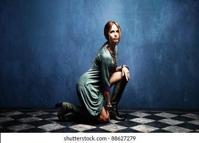 beautiful woman posing on floor,  full body shot, indoor shot