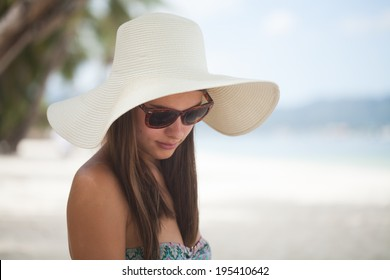 Beautiful woman posing on a paradise beach