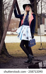 Beautiful woman in posing outdoors