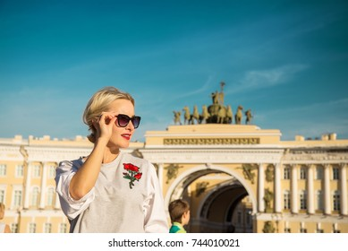 Beautiful woman posing over Palace Square in St. Petersburg