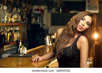 Beautiful woman posing in the pub