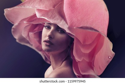 Beautiful woman posing with rose flower