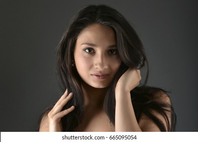 Beautiful woman posing in studio on dark background