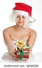 Beautiful woman posing at studio in santa hat