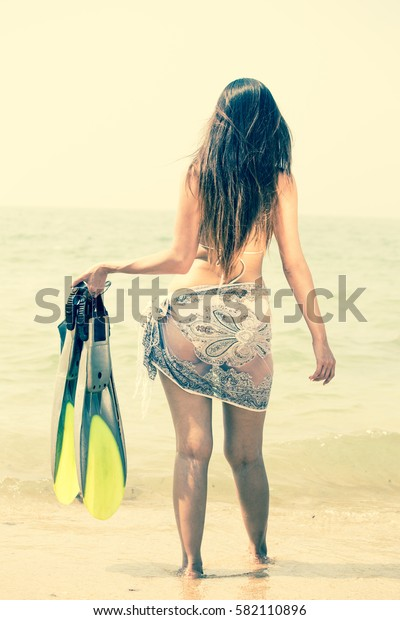 Beautiful woman posing at the summer sand beach. Outdoor summer portrait, vintage color style.