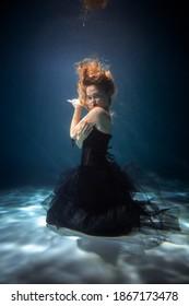 Beautiful WOMAN Posing under the Water. Copy Space. Art
