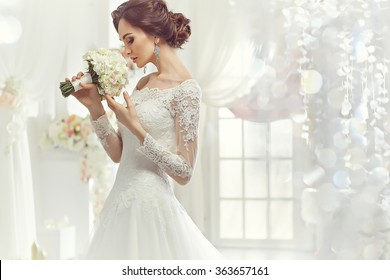 The beautiful woman posing in a wedding dress