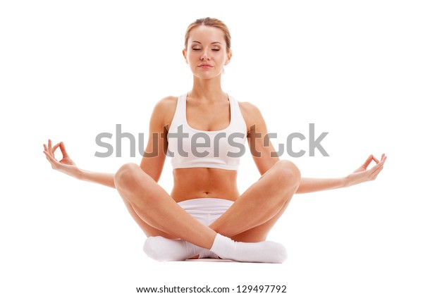 beautiful woman practicing yoga in lotus pose isolated over white