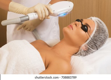 Beautiful woman in professional  beauty salon during photo rejuvenation procedure