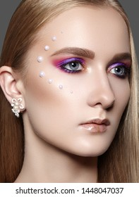 Beautiful Woman with Professional Creative Makeup with Perls. Celebrate Style Eye Make-up, Perfect Eyebrows, Shine Skin. Bright Fashion Look. Glow Skin with Shimmer