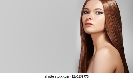 Beautiful Woman with Professional Makeup. Celebrate Make-up, Shine Skin. Bright Fashion Look with Straight Hair. Bright Fashion Look.